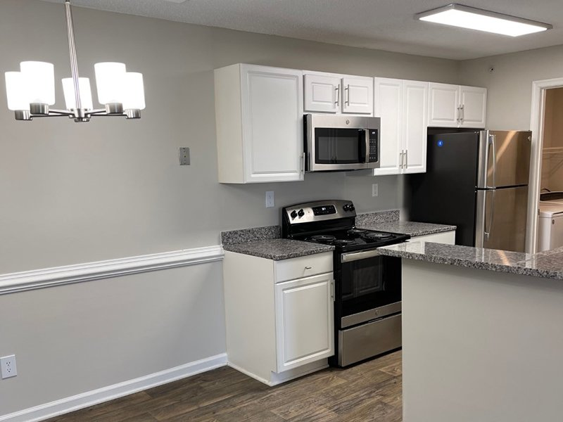 A dining area is attached to the kitchen at The Lakes at Town Center Apartments in Hampton.