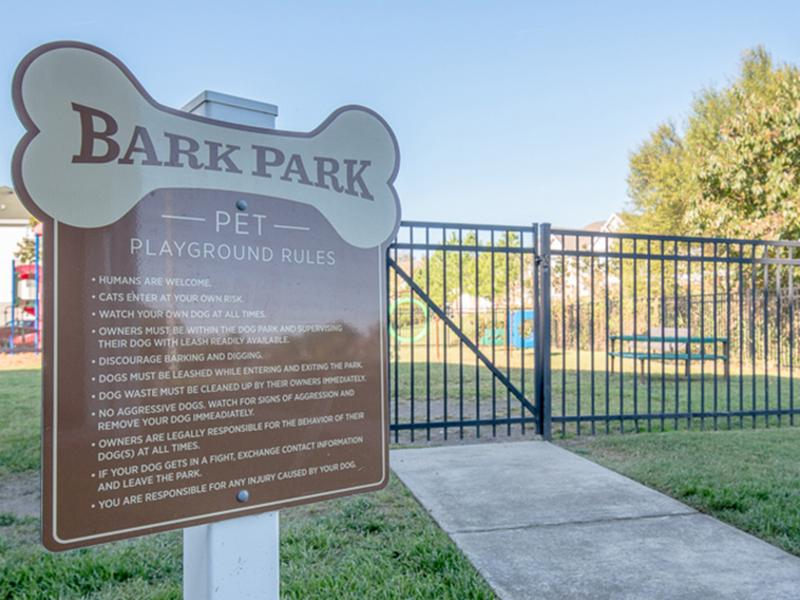 The sign to the bark park with pet playground rules at The Lakes at Town Center Apartments.