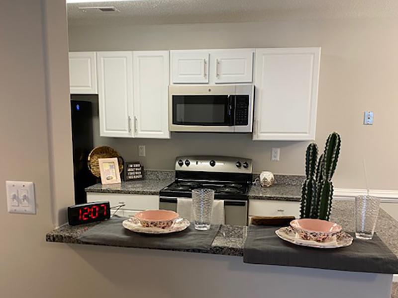 The Lakes at Town Center Apartments have kitchens with a breakfast bar.