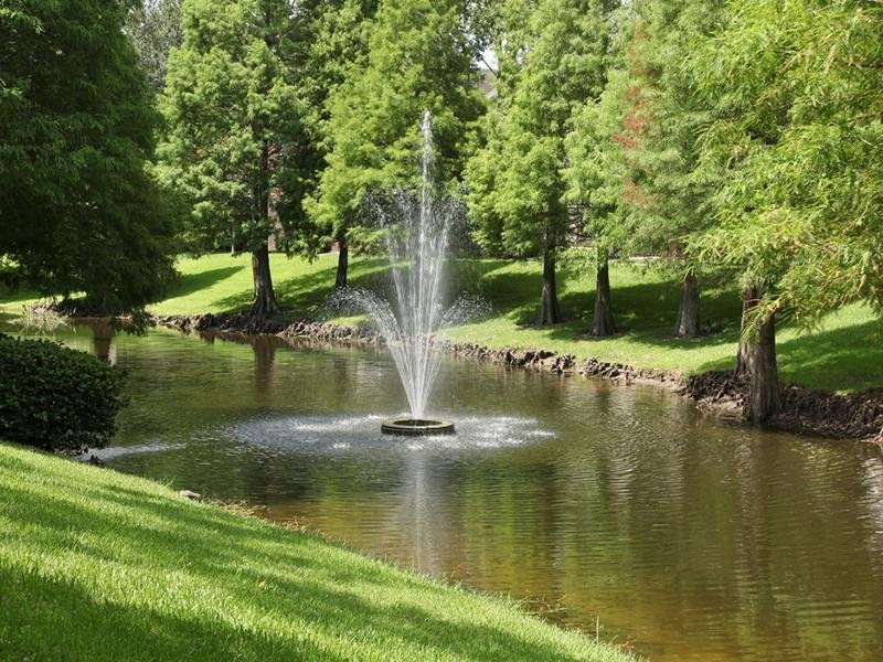 The landscaped grounds have a Lakes with a fountain.
