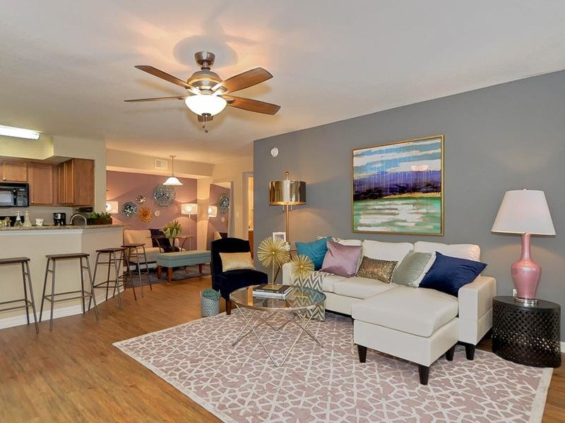 Model living room furnished with a couch and chairs at Providence Lakes Apartments in Brandon, FL