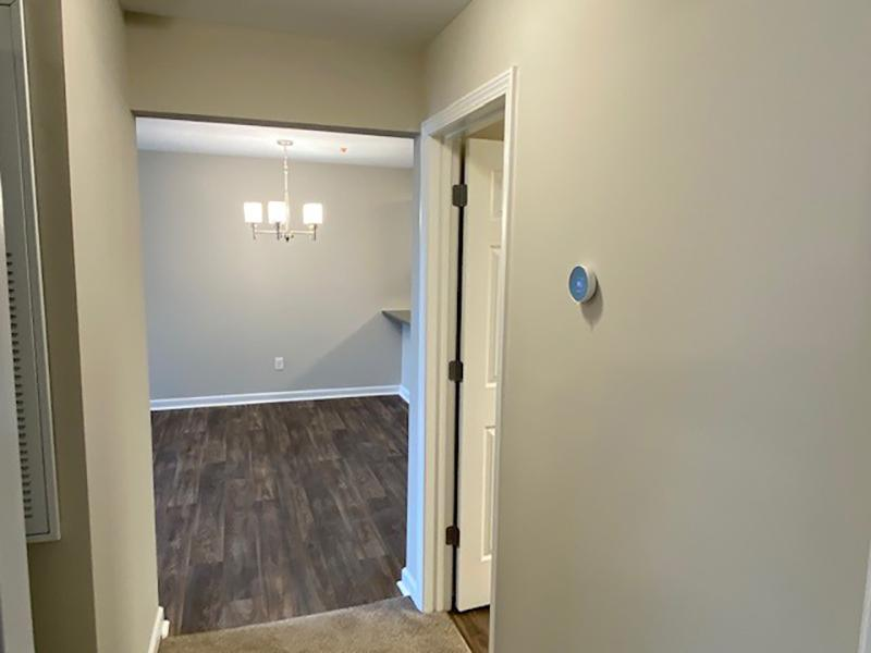 Ground level balcony with a sliding glass door at Retreat at Stonecrest Apartments in Lithonia, GA.
