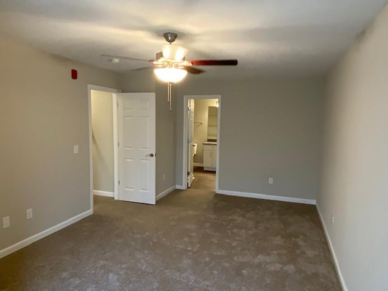 U-shaped kitchen in the apartments at Retreat at Stonecrest has stainless steel appliances and wood-style flooring.