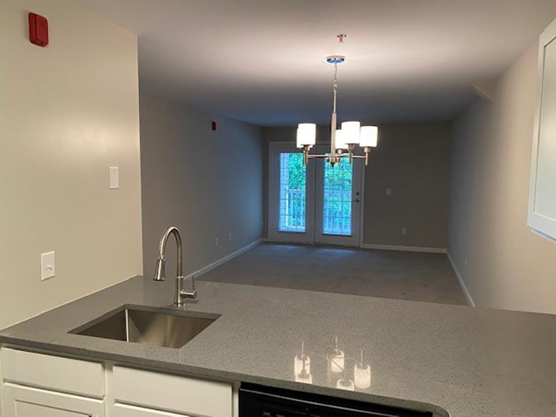In-unit laundry room with wash and dryer in an apartment at Retreat at Stonecrest in Lithonia, GA.