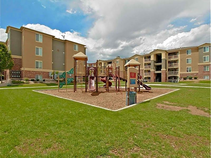 Exterior & Playground | eGate Apartments in West Valley, UT