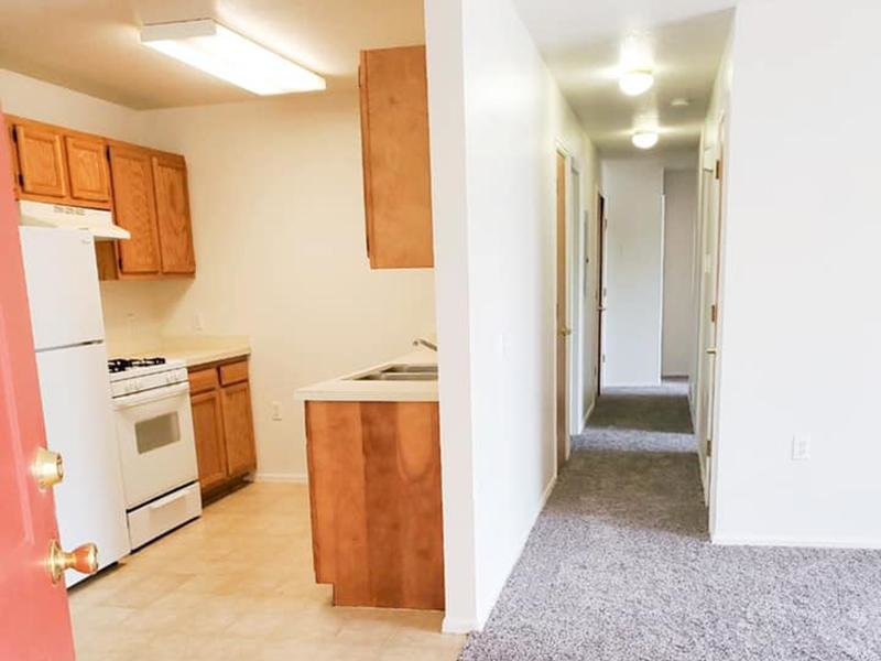 Kitchen and Living Room | Stonegate Village Apartments in Pueblo West, CO
