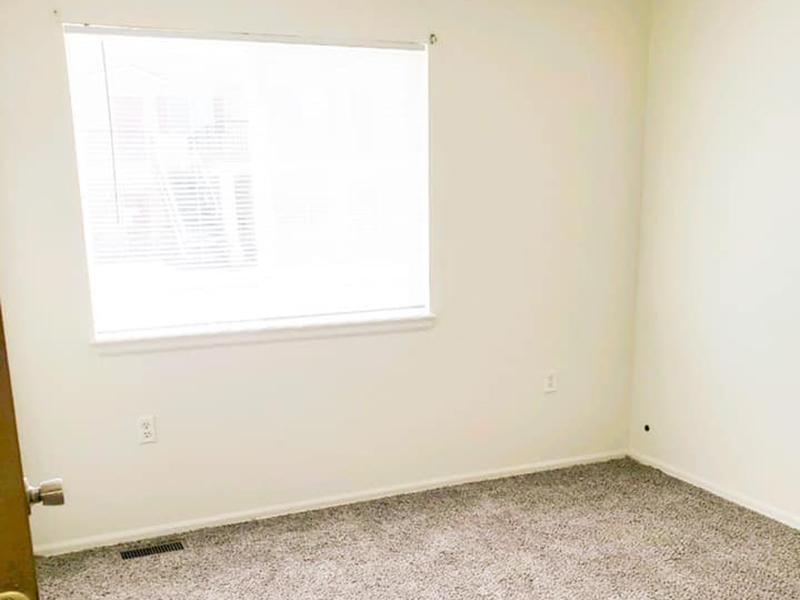 Bedroom | Stonegate Village Apartments in Pueblo West, CO