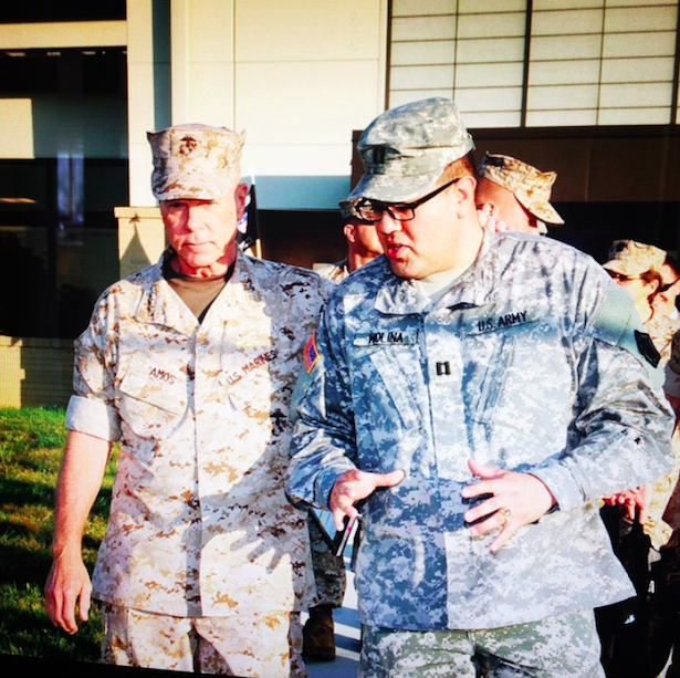 Commandant of the Marine Corps Gen. James Amos. General James F. Amos, and Capt David Molina, Joint Personal Effects Depot, Dover AFB, 2012