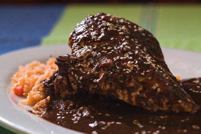 Pollo en Mole Estilo Oaxaca: Chicken breast prepared in a Oaxacan-style Mole Negro sauce