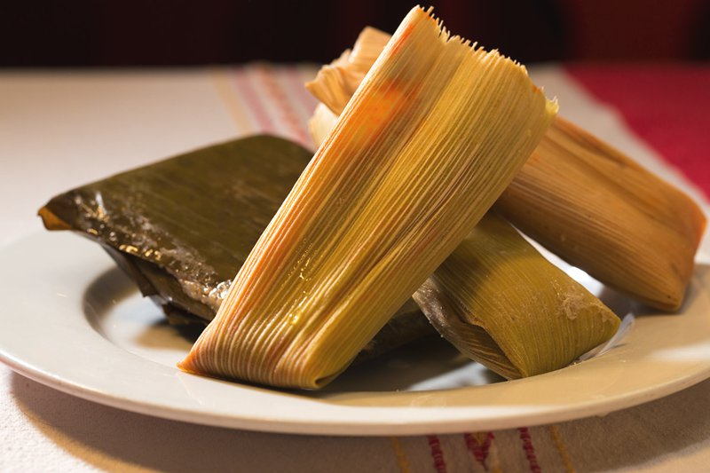 Cornhusks filled with steamed white cornmeal and your choice of green chiles and cheese or shredded red chile beef