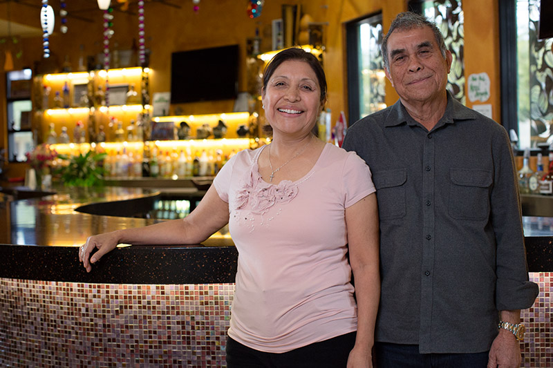 Portrait of Teresa & Alfonso Matias in front of the Tequila Bar