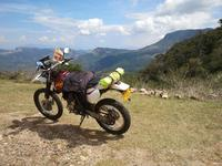 Dual sport motorcycle sits on top of mountain in Sri Lanka