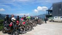 Dual sport touring bikes in line, waiting to begin tour