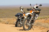 Motorbikes rest on the road in South Africa northern Cape.