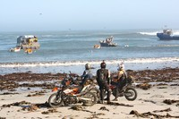 Motorcycle tour looks out at ocean on South Africa's west coast