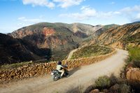 Motorbike descending from mountain range in South Africa