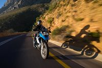 Rider on dual sport motorcycle moves by in a blur