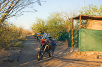 Motorbike stands next to rural campsite in South Africa