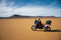 Dual sport motorcycle parked in the desert of south africa