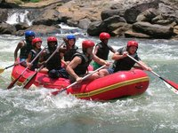 Group takes a break from adventure touring to raft the Kelani river in Sri Lanka