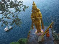 Gold statue rises high above the water's edge