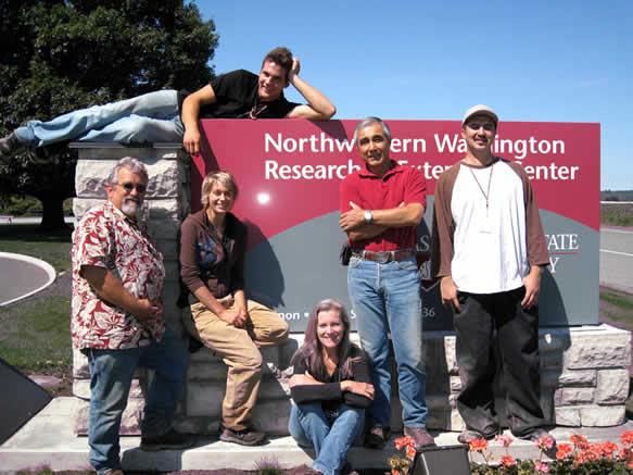 Entomology program staff pose with the NWREC sign.