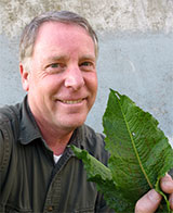 Photo of Tim Miller holding dock weed leaves
