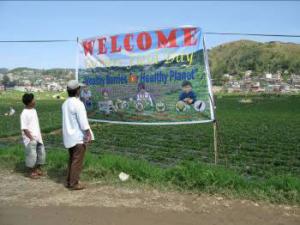 Men read a banner advertising biological control.
