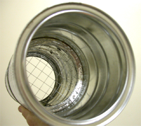 Wire mesh sandwiched between two cans with their ends removed.