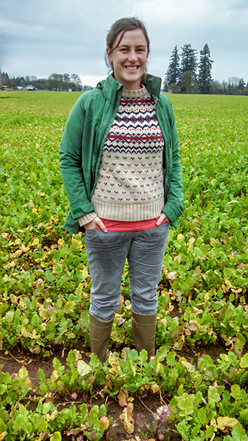 Shannon standing in a turnip seed crop in the Willamette Valley of Oregon that was infected with black leg, light leaf spot, and white leaf spot