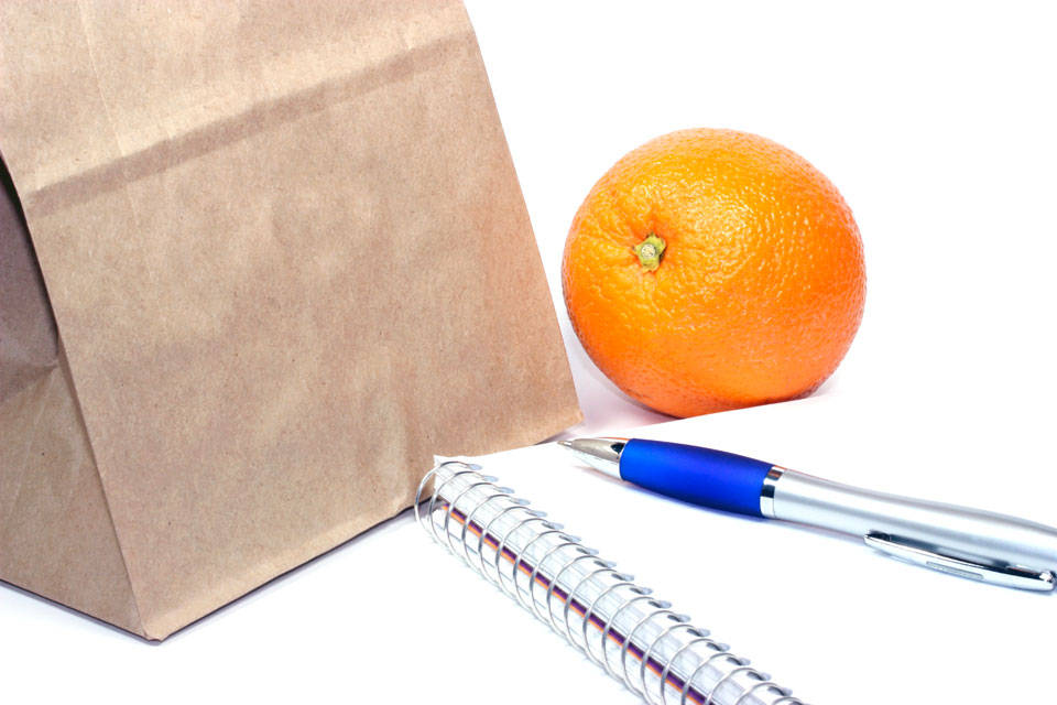 Lunch bag with notepad and pen.
