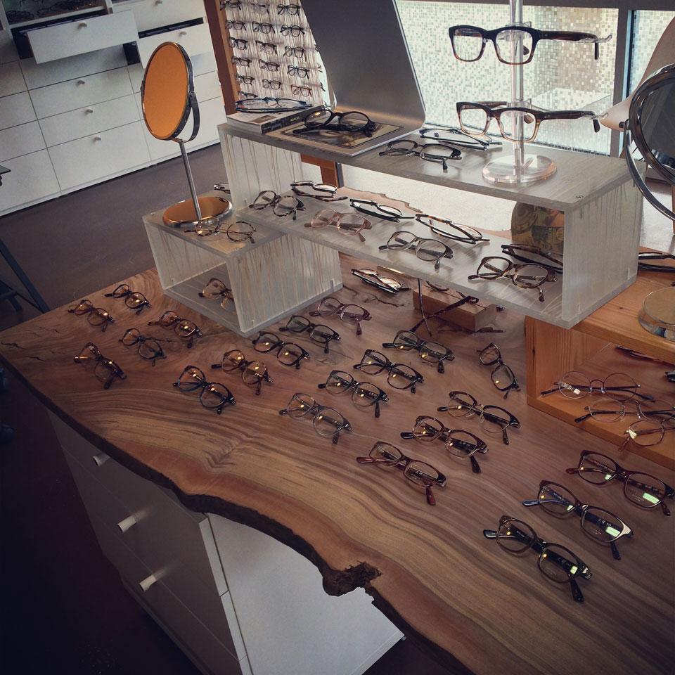 Myoptic eyewear displayed on a live edge wood slab