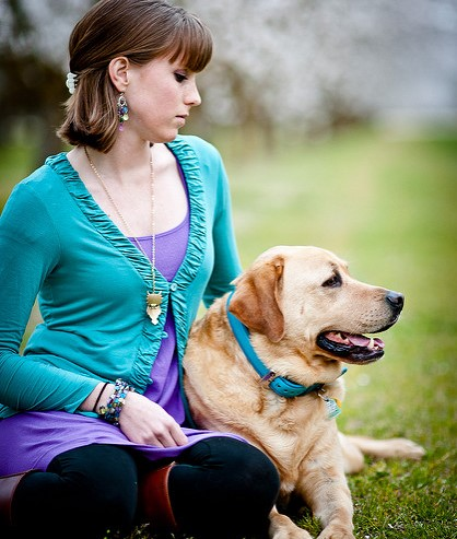 women sitting with support dog