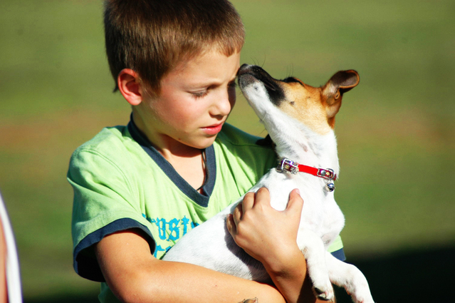 Boy with ADD holding Dog