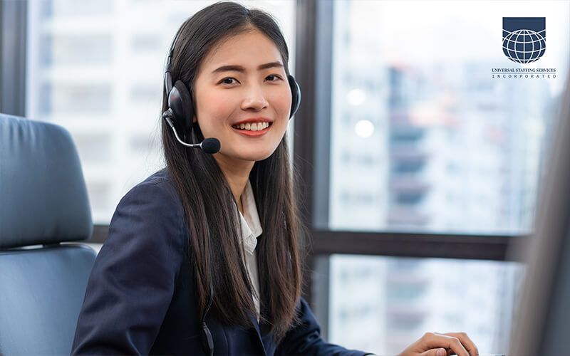 A customer service employee using a headset with a customer on the line