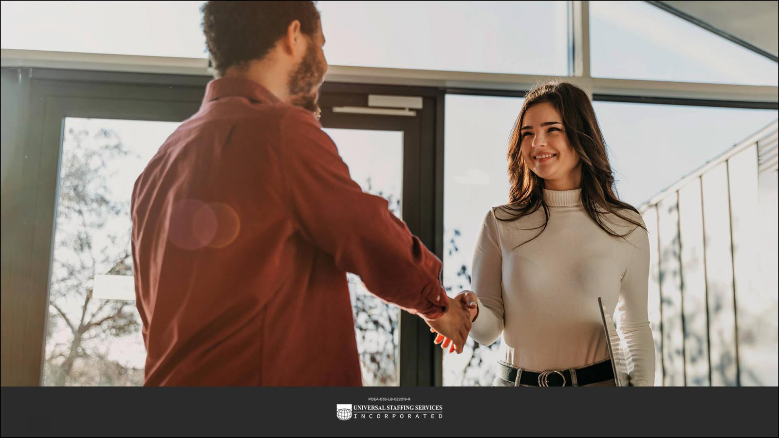 A person shaking hands with a company representative