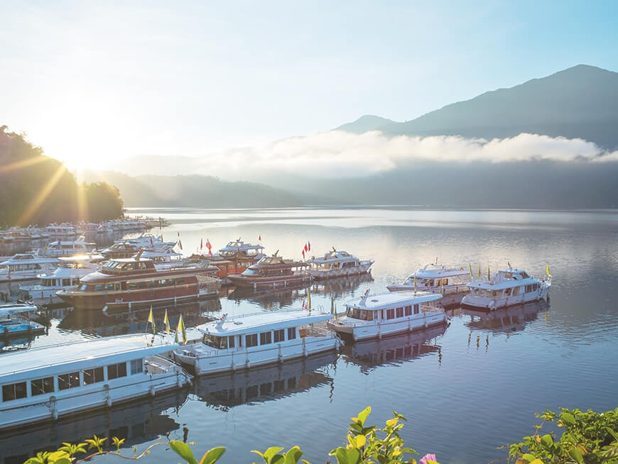 Enjoy the majestic scenery of Sun Moon Lake and go on a scenic shuttle boat tour