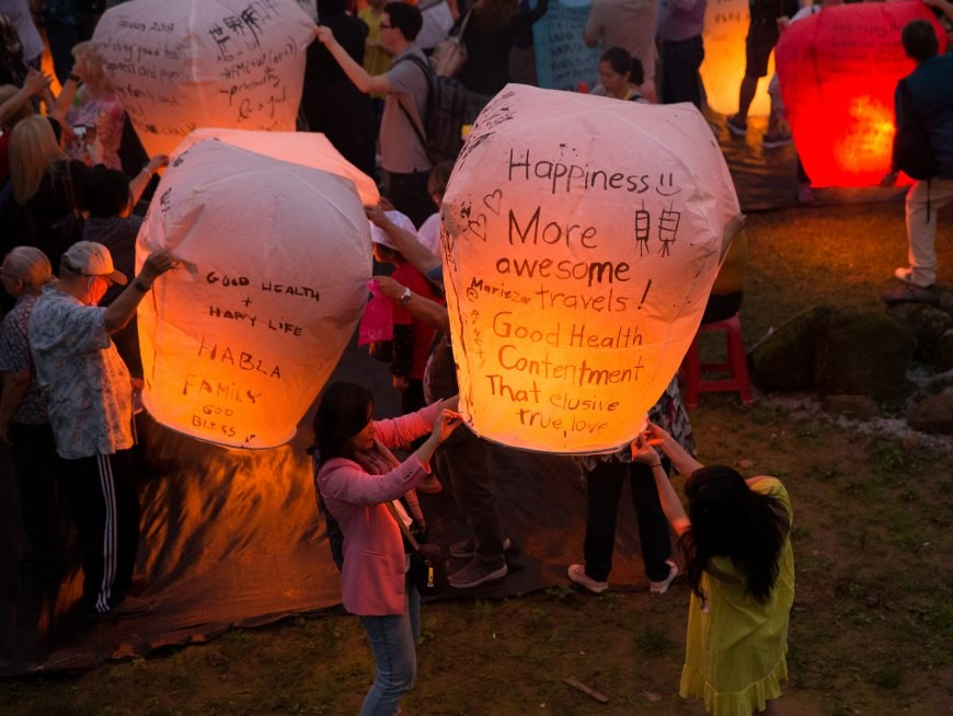 Marvel at the spectacle of 100+ sky lanterns rising in the evening sky
