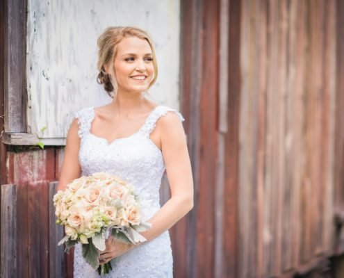 Bride in front of Barn at Butler's Courtyard