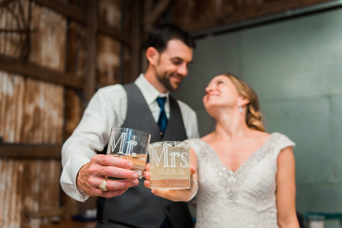 Montesino Ranch Wedding Reception bride and groom with whiskey glasses