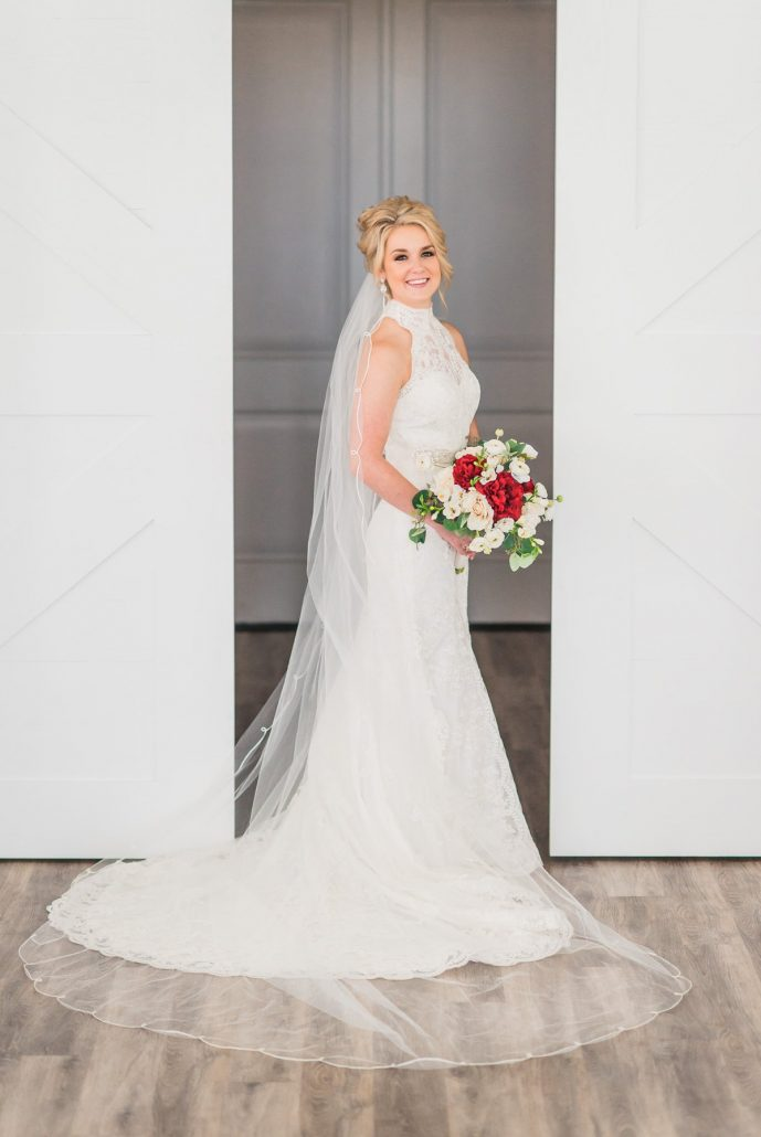 The Farmhouse Bridal Portrait with white barn doors