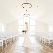 The Farmhouse Bridal Portraits with a white shiplap chapel