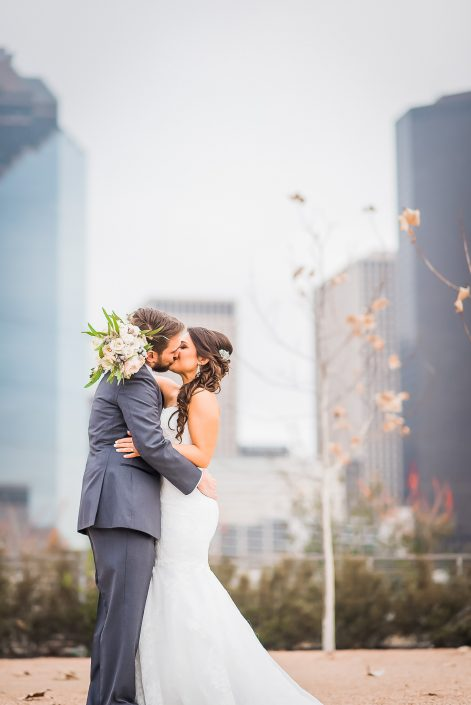 Bride and Groom with Houston Skyline by Houston Wedding Photographers Nate Messarra Photography