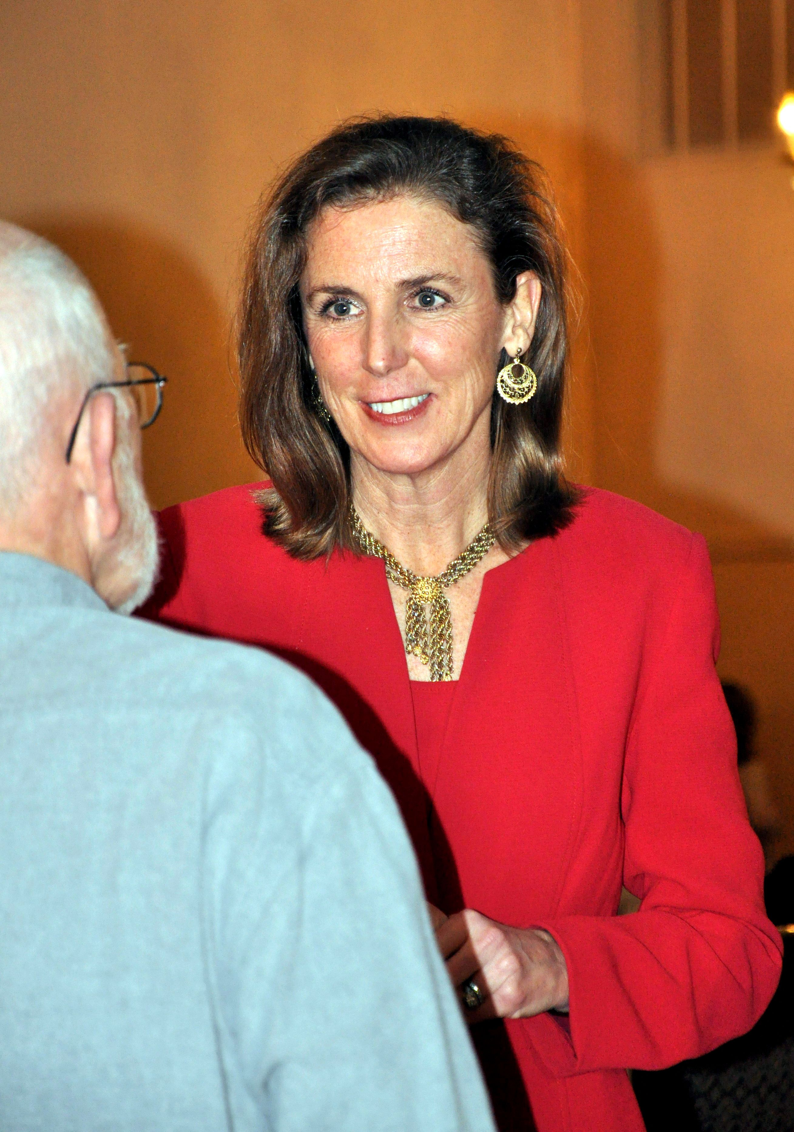 AMY MILLER/TIMES NEWS Katie McGinty, one of seven Democratic candidates for Pennsylvania governor, speaks with Carbon County resident Roy Christman Wednesday evening during a meet and greet at Kelly's Irish Pub in Lansford.