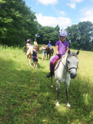 Children enjoy horseback riding at a summer camp at Apollo Farms in Palmerton. CONTRIBUTED PHOTO