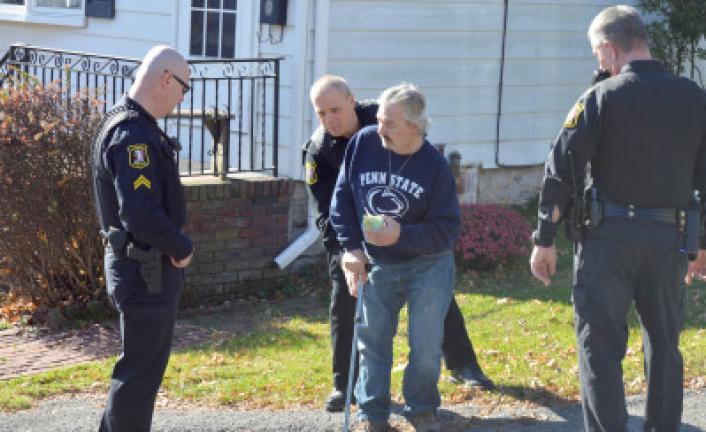 Tamaqua patrolman Rick Bekesy searches Steven Marsicano, 48, of 223 Lehigh St., Tamaqua, on Monday morning. KATHY KUNKEL/TIMES NEWS