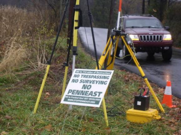 PennEast set up their surveying equipment next to Paul Shinsec's no trespassing sign on Pohopoco Drive and State street. Police were called and the surveyors moved across the highway. CONTRIBUTED PHOTO
