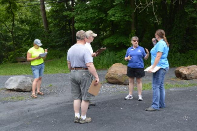 Martha Capwell Fox speaks to Alice Wanamaker, Dean Hower and Dale Reed while Elizabeth Wagner conducts a trail survey at the Slatington Trailhead.