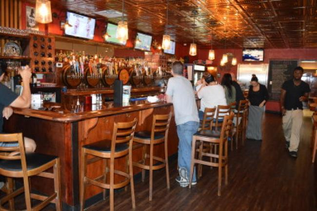 The bar at Bonnie & Clyde Pub and Grill in Lehighton serves 36 beers on tap and 60 other varieties of craft beers in bottles. KRISTINE PORTER/TIMES NEWS