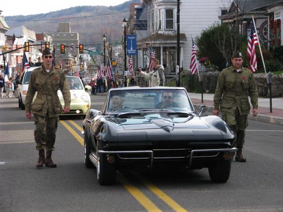 LIZ PINKEY/SPECIAL TO THE TIMES NEWS George Breunig (seated in car, left), a US Navy veteran, wore his 1943 uniform to the Tamaqua Veterans Day Parade. A World WarII veteran, Breunig served as a petty officer, gunner's mate during the War.